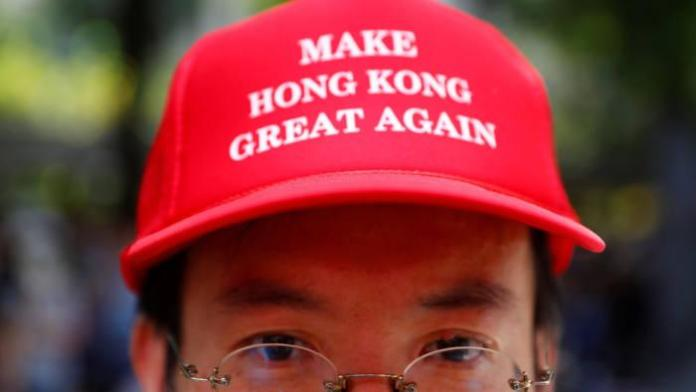 "A protester is seen wearing a cap that reads, ""Make Hong Kong Great Again"" in Central, Hong Kong, China September 8, 2019. REUTERS/Kai Pfaffenbach"