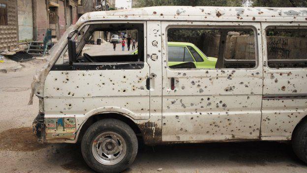 Syria conflict: Defiance inside Damascus rebel suburb - BBC News
