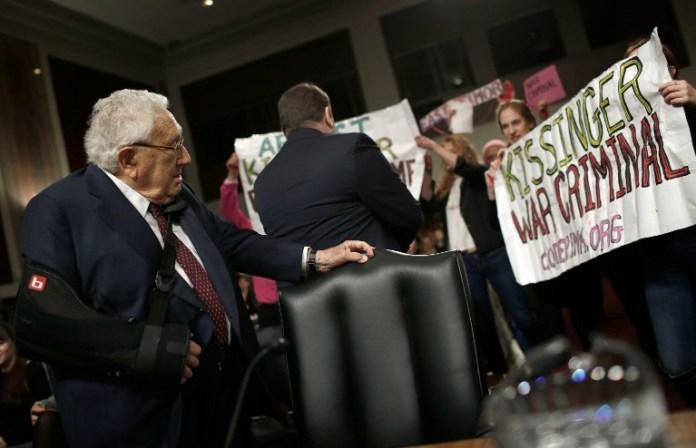 Protesters heckle Kissinger, denounce him for 'war crimes'   The Times of  Israel