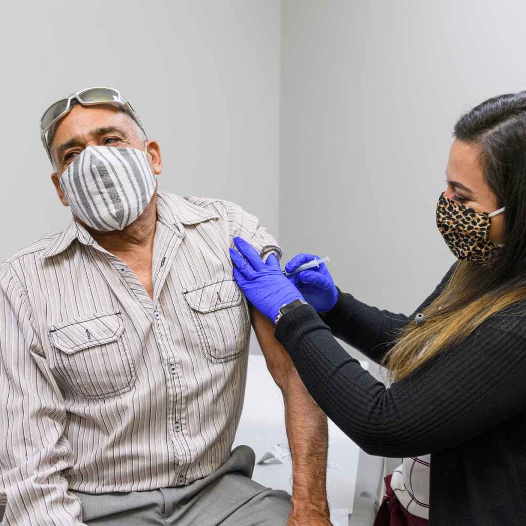Picture of man getting vaccine