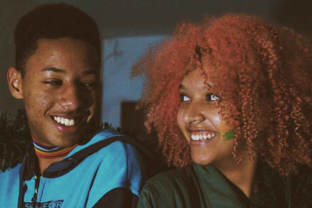 cheerful young african american couple looking at each other while spending time together