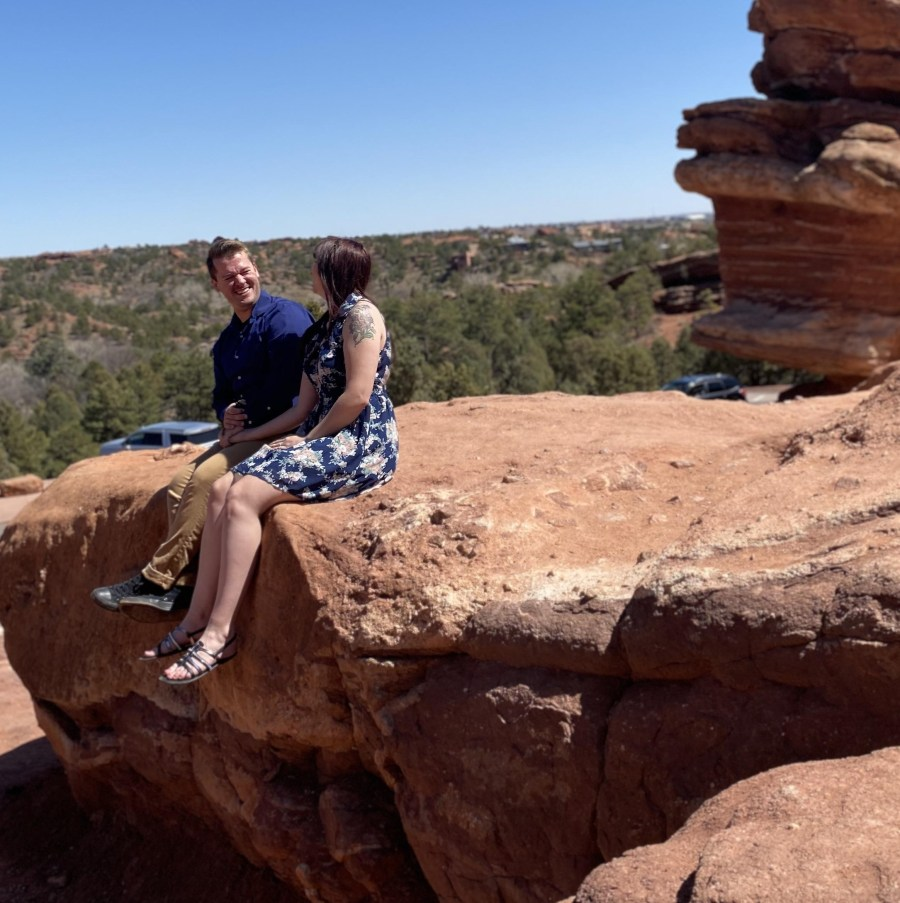 Two people sitting on a rock