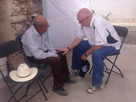 praying with a man who was sick
