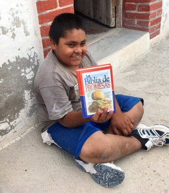 Yasir loves his new Bible! He's a miracle story!
