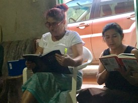 Guadalupe and Mikiela sitting in the doorway during Bible study- it was crowded in that little block house!