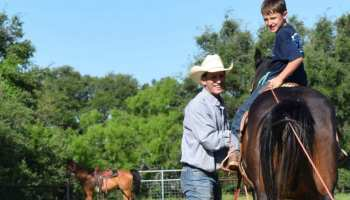 father son roping branding horse cowgirl magazine