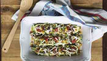 calabacitas rellenas with homemade queso blanco on a tray with a spoon recipe cowgirl magazine