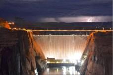 A high desert thunderstorm lights up the sky behind Glen Canyon Dam -- Photo USBR