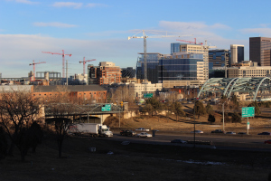 Construction cranes fill the Denver skyline, a sign of the city's growing population.