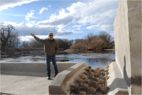 Scott Hummer shows off a fish passage at a North Poudre Irrigation Company diversion structure. His agency worked with Fort Collins Natural Areas and Colorado Parks and Wildlife to include a fish passage when the irrigation company replaced a diversion structure on the Poudre River that was destroyed by the 2013 floods. Work was completed [in February 2016]. (Pamela Johnson / Loveland Reporter-Herald)