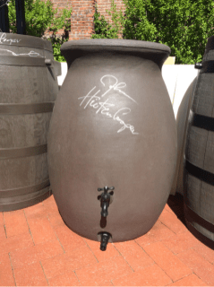 Governor Hickenlooper signed a rain barrel at the HB16-1005 bill signing ceremony. Photo via @jessica_goad and Twitter.