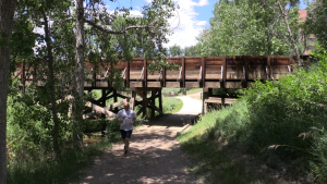 A jogger runs past a flume used to carry the High Line Canal over Lee Gulch in Littleton.