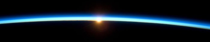 The earth's atmosphere and the setting sun, viewed from the Space Shuttle. Most of the Earth's atmosphere is within 10 miles of the surface. (Source: NASA)
