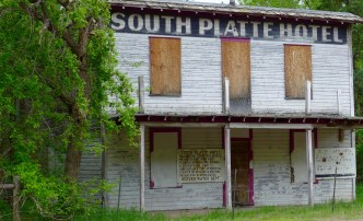 The South Platte Hotel building that sits at the Two Forks site, where the North and South forks of the South Platte River come together. Photo: Brent Gardner-Smith/Aspen Journalism