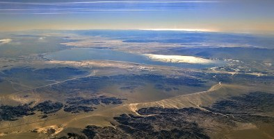 Aerial view of the Salton Sea from the north-northeast (from over Joshua Tree National Park), looking into the early afternoon sun. Photo credit: Dicklyon via Wikimedia Commons