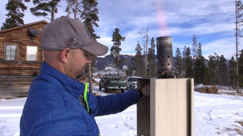 Eric Hjermstad, field operations director, Western Weather Consultants, lights a cloud seeding generator north of Silverthorne, Colorado. Photo credit: Denver Water