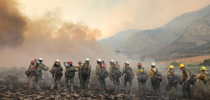 Firefighters on the march: The Pine Gulch Fire, smoke of which shown here, was started by alighting strike on July 31, 2020, approximately 18 miles north of Grand Junction, Colorado. According to InciWeb, as of August 27 2020, the Pine Gulch Fire became the largest wildfire in Colorado State history, surpassing Hayman Fire that burned near Colorado Springs in the summer of 2002. Photo credit: Bureau of Land Mangement-Colorado, via InciWeb and National Interagency Fire Center.
