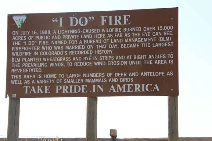 This sign along the highway between Craig and Dinosaur, in northwestern Colorado, tells of a fire in 1988 that burned 15,000 acres, then the most in Colorado's recorded history. The Cameron Peak Fire in 2020 burned nearly 209,000 acres. Photo credit: Allen Best via Big Pivots