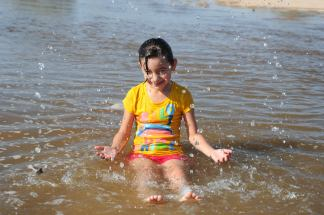 Young girl enjoying the river restored temporarily by the pulse flow March 2014 via National Geographic