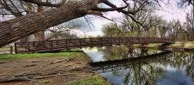 Poudre River Bike Path bridge over the river at Legacy Park photo via Fort Collins Photo Works.