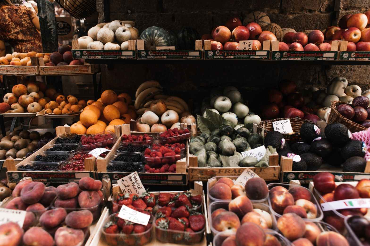 assorted fruits on a fruit stand