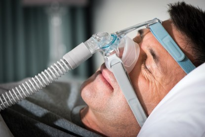 Closeup of Man Sleeping with CPAP Mask