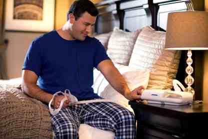 Man Using CPAP Machine - cpapRX