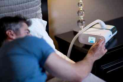 Man Using CPAP Machine - cpapRX