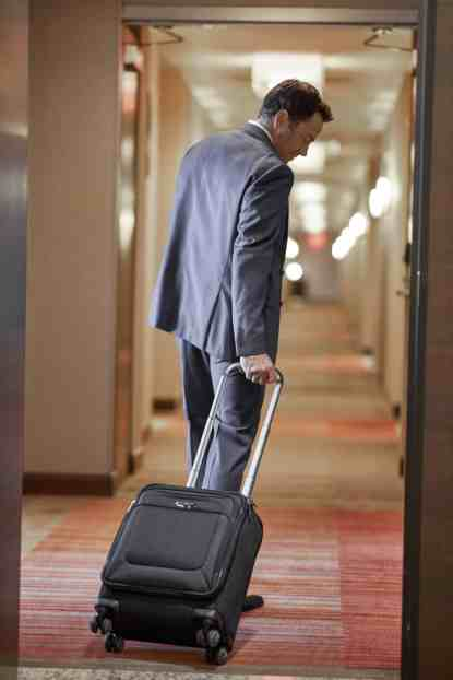 Man with Suitcase in Hotel - cpapRX