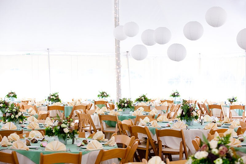A look inside a tent set for fine dining during a wedding or oth