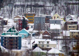 Apartment buildings and homes in winter, Berlin, NH