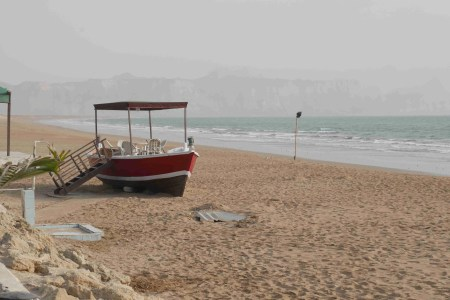 A handcrafted fishing boat transformed in casual seating along the beach in Gwadar, Pakistan. (Photo Credit: Arif Rafiq)