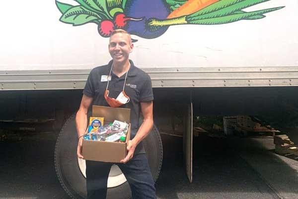 man holding food box volunteer