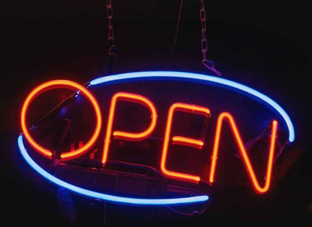 oval blue and orange open neon signage turned on