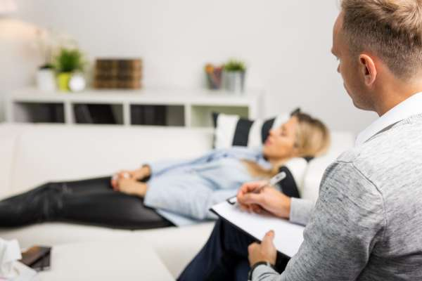 Woman getting Hypnotherapy Treatment