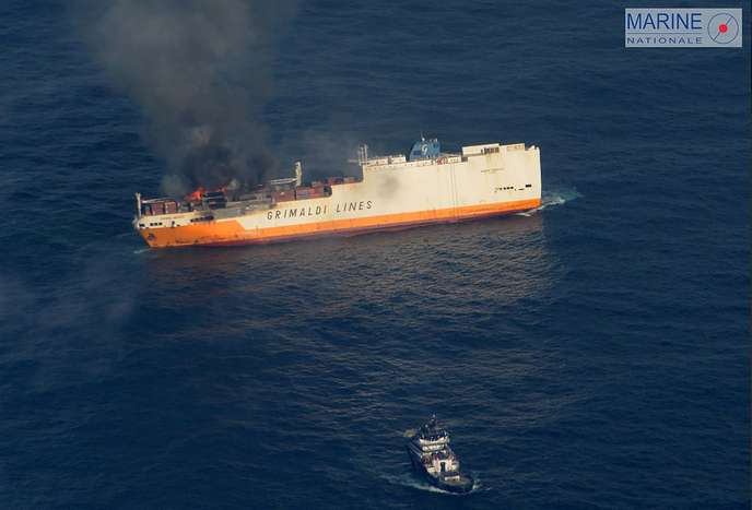 This handout picture released on March 11, 2019 by the French Marine Nationale shows flames on the Italian merchant ship Grande America off the coasts of the French Brittany. The crew of the Royal Navy grigate HMS Argyll has saved all 27 members aboard the Italian cargo ship after its containers and cars caught fire off the coast of France. The ship's crew were unable to fight the flames and were abandoning the ship. - RESTRICTED TO EDITORIAL USE - MANDATORY CREDIT