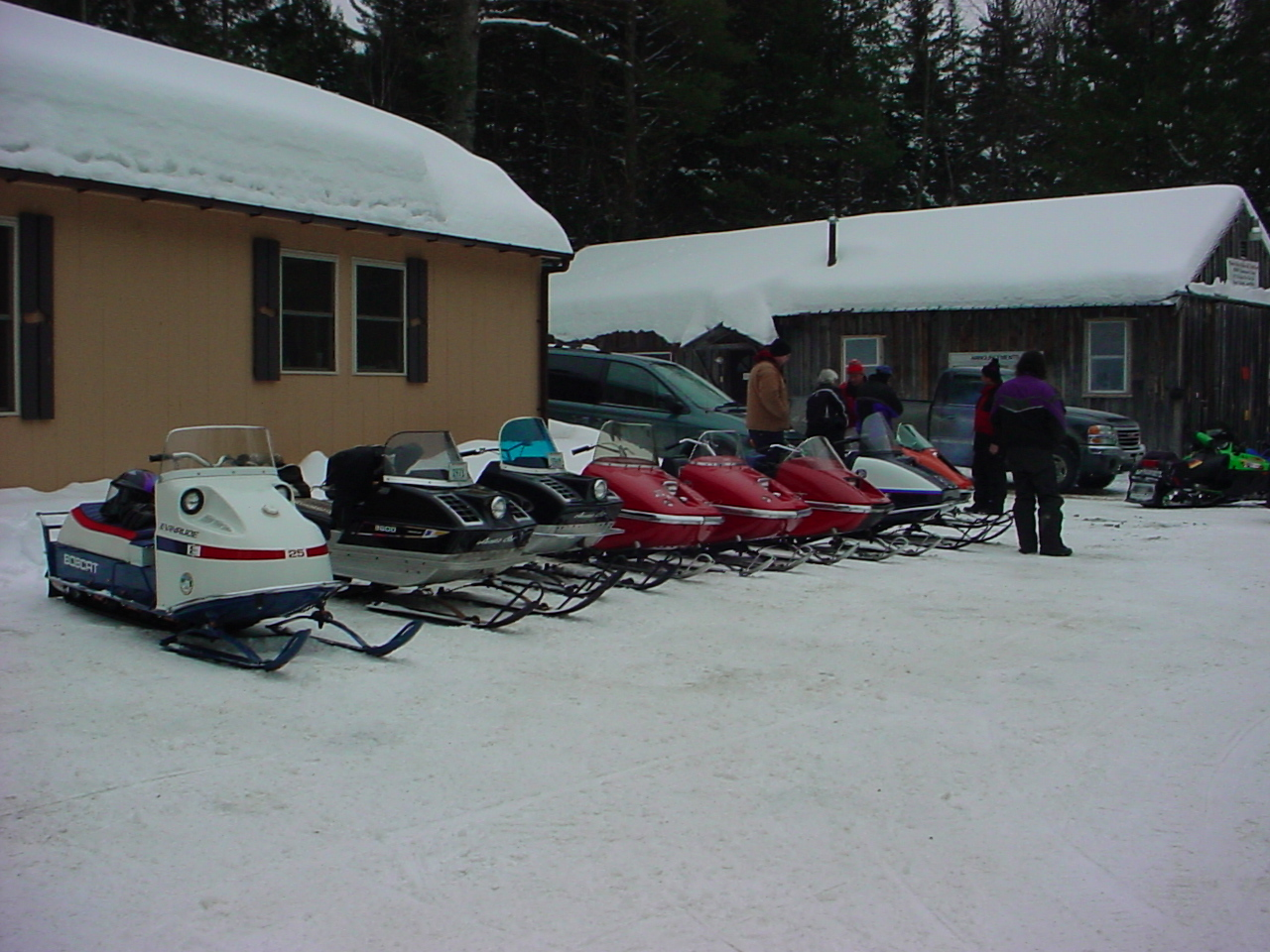 Evinrude, Arctic Cats and Tom's Rupps in front of the club house