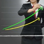 Woman in suit presenting data graph