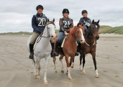 Aurora Raffeah with Janina, Aurora Reniah with Robin, and Mystique with Kimberley on Oreti Beach during the latest Mt Linton Endurance Ride.