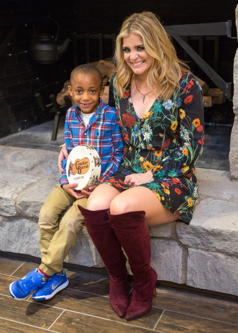 Lauren poses with an excited young fan