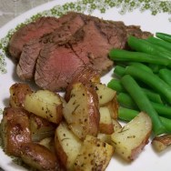 vension tenderloin, roasted potatoes, and green beans