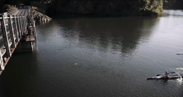 paddling under bridge