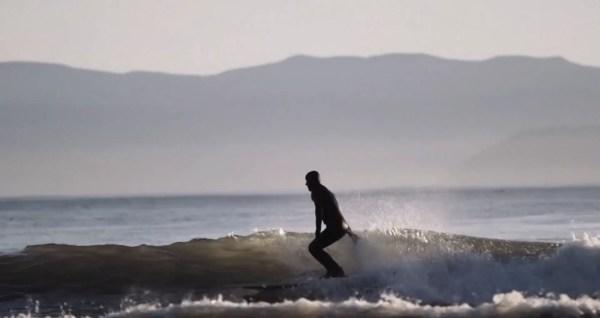 Surfer skimming wave