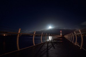 Supermoon over lighthouse