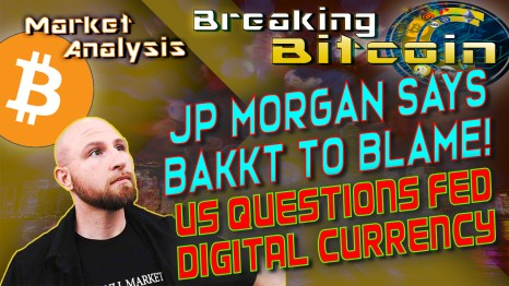 text jp morgan says bakkt to blame! US questions FED digital currency next to justin looking up at words with graphic background and bitcoin logo