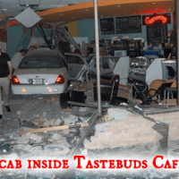 Blacktop Cab Drives Into Tastebuds Cafe.