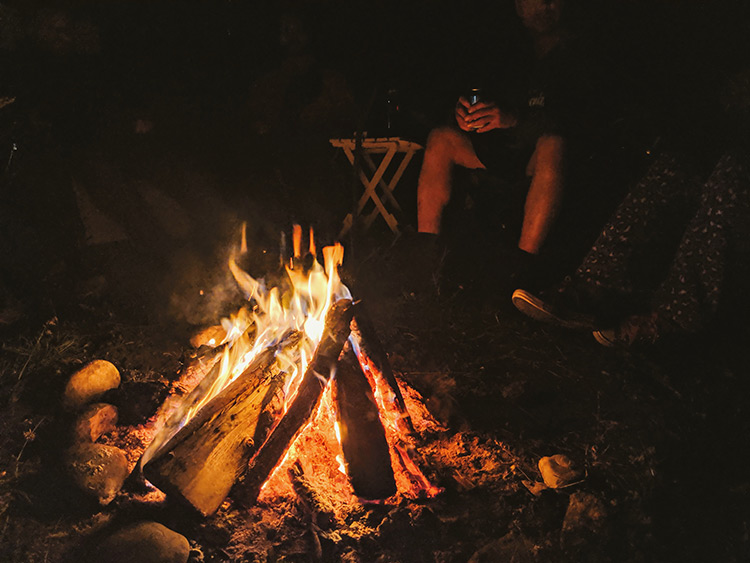 Karma Campervans campfire with friends