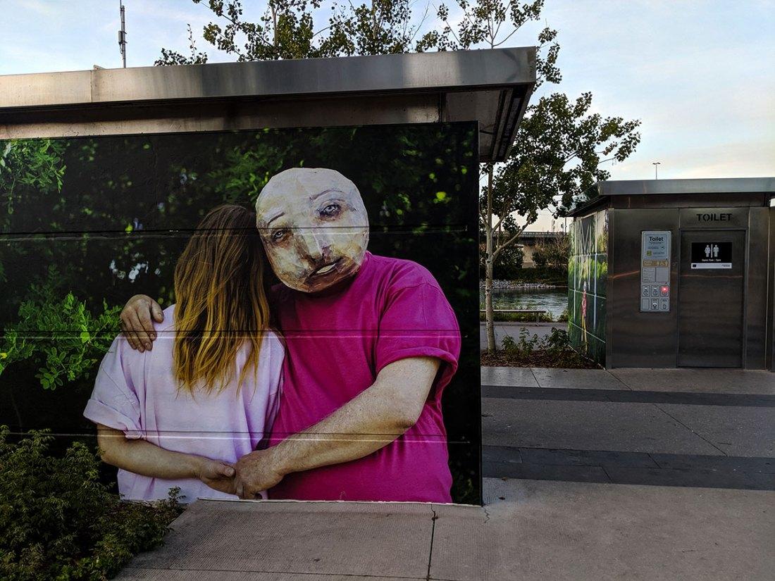 East Village Mask Mural Stairs hug