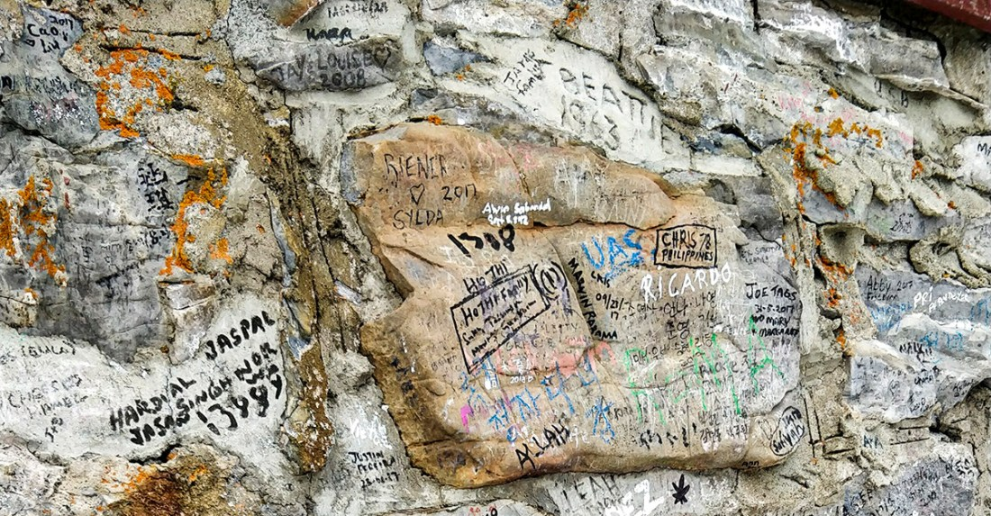 Guide To The Banff Gondola Sanson's Peak side of building names and dates etched and drawn on the wall