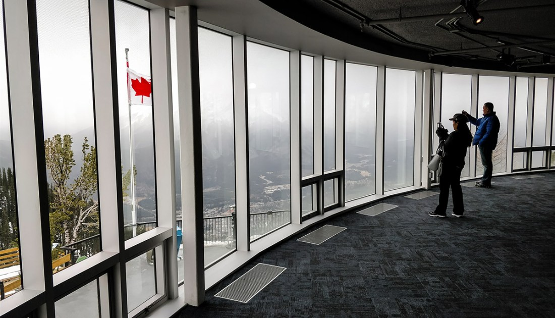 Guide To The Banff Gondola inside observation deck upper terminal overlooking bow valley and town of Banff